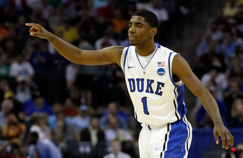CHARLOTTE, NC - MARCH 18:  Kyrie Irving #1 of the Duke Blue Devils points in the first half while taking on the Hampton Pirates during the second round of the 2011 NCAA men's basketball tournament at Time Warner Cable Arena on March 18, 2011 in Charlotte,