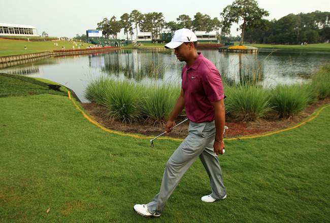 PONTE VEDRA BEACH, FL - MAY 11:  Tiger Woods walks to a tee during a practice round prior to the start of THE PLAYERS Championship held at THE PLAYERS Stadium course at TPC Sawgrass on May 11, 2011 in Ponte Vedra Beach, Florida.  (Photo by Streeter Lecka/