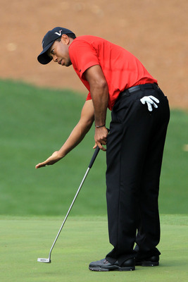 AUGUSTA, GA - APRIL 10: Tiger Woods reacts to a putt during the final round of the 2011 Masters Tournament on April 10, 2011 in Augusta, Georgia.  (Photo by David Cannon/Getty Images)