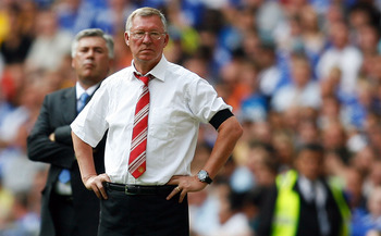 LONDON, ENGLAND - AUGUST 09:  Sir Alex Ferguson manager of Manchester United and Carlo Ancelotti manager of Chelsea look on during the FA Community Shield match between Manchester United and Chelsea at Wembley Stadium on August 9, 2009 in London, England.