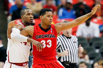 ATLANTA, GA - MARCH 11:  Trey Thompkins #33 of the Georgia Bulldogs vies for position with Chris Hines #44 of the Alabama Crimson Tide during the quarterfinals of the SEC Men's Basketball Tournament at Georgia Dome on March 11, 2011 in Atlanta, Georgia.