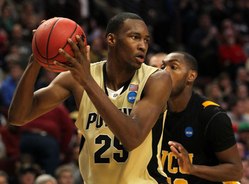 CHICAGO, IL - MARCH 20:  JaJuan Johnson #25 of the Purdue Boilermakers looks to pass against Ed Nixon #50 of the Virginia Commonwealth Rams in the second half during the third round of the 2011 NCAA men's basketball tournament at the United Center on Marc