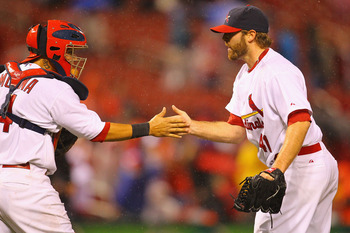 ST. LOUIS, MO - APRIL 24: Reliever Mitchell Boggs #41 and Yadier Molina #4 of the St. Louis Cardinals celebrate defeating the Cincinnati Reds at Busch Stadium on April 24, 2011 in St. Louis, Missouri.  (Photo by Dilip Vishwanat/Getty Images)