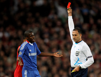 MANCHESTER, ENGLAND - APRIL 12:  Referee Olegario Benquerenca shows a red card to Ramires of Chelsea during the UEFA Champions League Quarter Final second leg match between Manchester United and Chelsea at Old Trafford on April 12, 2011 in Manchester, Eng