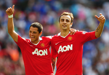 LONDON, ENGLAND - AUGUST 08:  Dimitar Berbatov of Manchester United (R) celebrates with Javier Hernandez as he scores their third goal during the FA Community Shield match between Chelsea and Manchester United at Wembley Stadium on August 8, 2010 in Londo