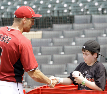 HOUSTON - APRIL 08:  Right fielder Hunter Pence of the Houston Astros shakes hands with eleven year old Kendal Robinson during batting practice before the game against the Florida Marlins at Minute Maid Park on April 8, 2011 in Houston, Texas.  (Photo by