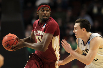 CHICAGO, IL - MARCH 20:  Chris Singleton #31 of the Florida State Seminoles drives against Ben Hansbrough #23 of the Notre Dame Fighting Irish in the second half during the third round of the 2011 NCAA men's basketball tournament at the United Center on M