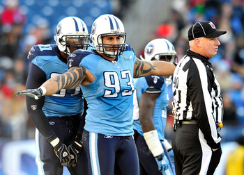 NASHVILLE, TN - DECEMBER 19:  Jason Babin #93 of the Tennessee Titans gestures to the Houston Texans offense during a timeout at LP Field on December 19, 2010 in Nashville, Tennessee. The Titans defeated the Texans, 31-17.  (Photo by Grant Halverson/Getty