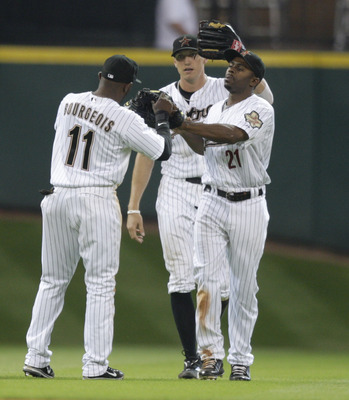 HOUSTON - APRIL 14:  Michael Bourn #21, Jason Bourgeois #11 and Hunter Pence #9 celebrate after the final out against the  San Diego Padres at Minute Maid Park on April 14, 2011 in Houston, Texas.  (Photo by Bob Levey/Getty Images)