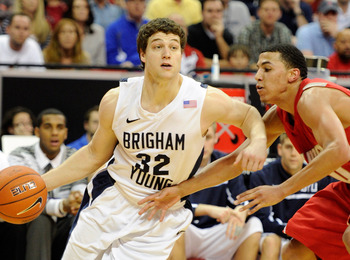 LAS VEGAS, NV - MARCH 11:  Jimmer Fredette #32 of the Brigham Young University Cougars drives against Kendall Williams #10 of the New Mexico Lobos during a semifinal game of the Conoco Mountain West Conference Basketball tournament at the Thomas & Mack Ce