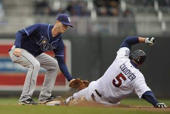 MINNEAPOLIS, MN - APRIL 28: Shortstop Reid Brignac #15 of the Tampa Bay Rays tags out Michael Cuddyer #5 of the Minnesota Twins at second base during in the eighth inning of their game on April 28, 2011 at Target Field in Minneapolis, Minnesota. Rays defe