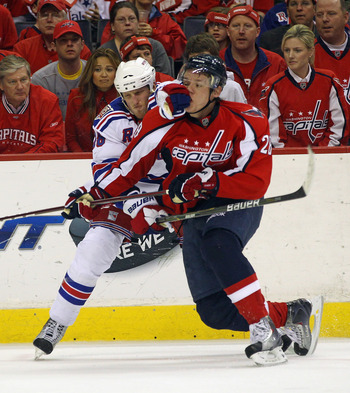 WASHINGTON, DC - APRIL 15: Marc Staal #18 of the New York Rangers holds onto Alexander Semin #28 of the Washington Capitals in Game Two of the Eastern Conference Quarterfinals during the 2011 NHL Stanley Cup Playoffs at Verizon Center on April 15, 2011 in