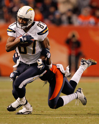 DENVER, CO - JANUARY 2:  Wide receiver Kelley Washington #87 of the San Diego Chargers is tackled after a reception by cornerback Syd'Quan Thompson #22 of the Denver Broncos during the fourth quarter at INVESCO Field at Mile High on January 2, 2011 in Den