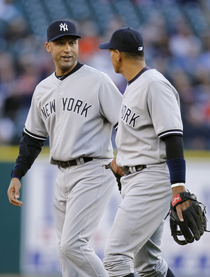 DETROIT, MI - MAY 04: Derek Jeter #2 of the New York Yankees talks with Alex Rodriguez #13 while playing the Detroit Tigers at Comerica Park on May 4, 2011 in Detroit, Michigan. Detroit won the game 4-0.(Photo by Gregory Shamus/Getty Images)