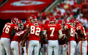 KANSAS CITY, MO - AUGUST 29: Quarterback Matt Cassel #7 of the Kansas City Chiefs huddles up with his teammates on offense2 including Dwayne Bowe #82 and Devard Darling #81 against the Seattle Seahawks during their preseason game at Arrowhead Stadium on A