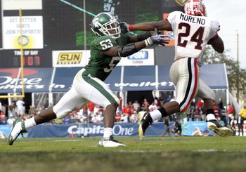 ORLANDO, FL - JANUARY 1: Running back Knowshon Moreno #24 of the University of Georgia rushes around linebacker Greg Jones #53 of the Michigan State Spartans at the 2009 Capital One Bowl at the Citrus Bowl on January 1, 2009 in Orlando, Florida.  (Photo b