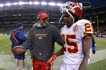 DENVER - JANUARY 03: Jamaal Charles #25 of the Kansas City Chiefs is offered the ball by head coach Todd Haley after Charles scored on a 56 yard fourth quarter touchdown run against the Denver Broncos during NFL action at Invesco Field at Mile High on Jan