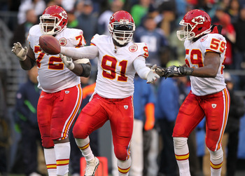 SEATTLE, WA - NOVEMBER 28:  Linebacker Tamba Hali #91 of the Kansas City Chiefs celebrates with Glenn Dorsey #72 and Jovan Belcher #59 after recovering a fumble on a sack of quarterback Matt Hasselbeck of the Seattle Seahawks at Qwest Field on November 28