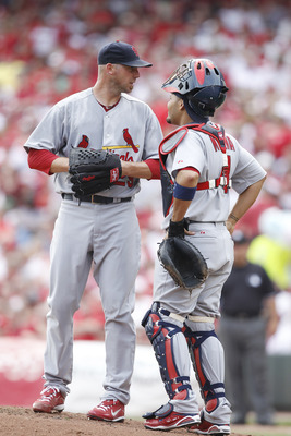 CINCINNATI, OH - APRIL 5: Chris Carpenter #29 and Yadier Molina #4 of the St. Louis Cardinals talk at the mound during the game against the Cincinnati Reds at the Great American Ball Park on March 5, 2010 in Cincinnati, Ohio. (Photo by Joe Robbins/Getty I