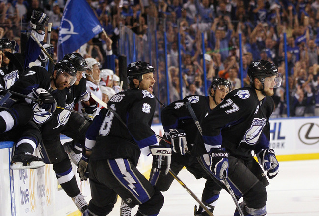 TAMPA, FL - MAY 04:  Randy Jones #8, Victor Hedman #77, and the Tampa Bay Lightning celebrate their 5-3 victory over the Washington Capitals in Game Four of the Eastern Conference Semifinals during the 2011 NHL Stanley Cup Playoffs at the St Pete Times Fo