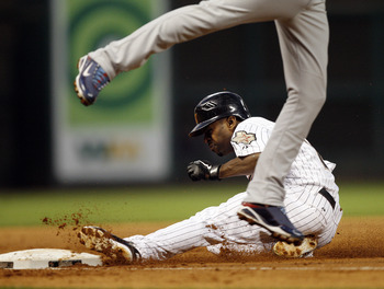 HOUSTON - APRIL 12:  Houston Astros' Michael Bourn #21 steals third base against the Chicago Cubs at Minute Maid Park on April 12, 2011 in Houston, Texas.  (Photo by Bob Levey/Getty Images)