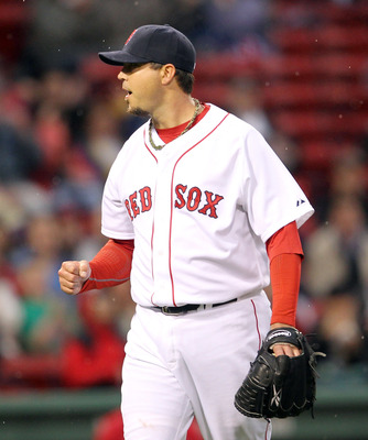 BOSTON, MA - MAY 4:  Josh Beckett #19 of the Boston Red Sox reacts after a double play in the first inning against the Los Angeles Angels of Anaheim at Fenway Park on May 4, 2011 in Boston, Massachusetts. (Photo by Jim Rogash/Getty Images)