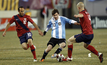 Messi trying to beat Bradley and Donovan