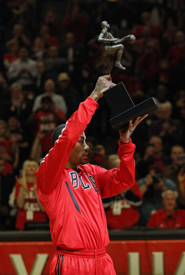 CHICAGO, IL - MAY 04: Derrick Rose #1 of the Chicago Bulls holds up the Maurice Podoloff Trophy awarded to the NBA Most Valuable Player before taking on the Atlanta Hawks in Game Two of the Eastern Conference Semifinals in the 2011 NBA Playoffs at the Uni