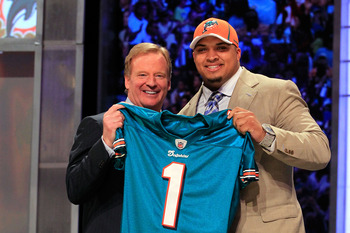 NEW YORK, NY - APRIL 28:  NFL Commissioner Roger Goodell poses for a photo with Mike Pouncey, #15 overall pick by the Miami Dolphins, on stage during the 2011 NFL Draft at Radio City Music Hall on April 28, 2011 in New York City.  (Photo by Chris Trotman/