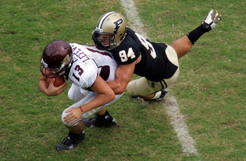 WEST LAFAYETTE, IN - SEPTEMBER 20:  Quarterback Dan LeFevour #13 of the Central Michigan Chippewas is tackled by Ryan Kerrigan #94 of the Purdue Boilermakers at Ross-Ade Stadium on September 20, 2008 in West Lafayette, Indiana.  (Photo by Ronald Martinez/