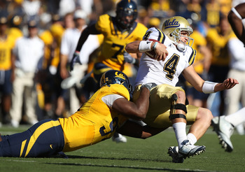BERKELEY, CA - OCTOBER 09:  Kevin Price #4 of the UCLA Bruins is tackled by Cameron Jordan #97 of the California Golden Bears at California Memorial Stadium on October 9, 2010 in Berkeley, California.  (Photo by Jed Jacobsohn/Getty Images)