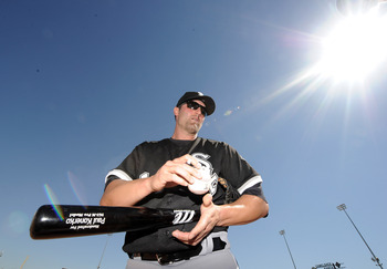 PHOENIX, AZ - FEBRUARY 28:  Paul Konerko #14 of the Chicago White Sox signs an autograph before the game against the Los Angeles Dodgers during spring training at Camelback Ranch on February 28, 2011 in Phoenix, Arizona.  (Photo by Harry How/Getty Images)