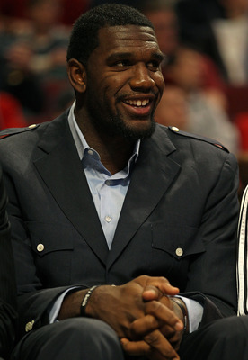 CHICAGO - NOVEMBER 01: Greg Oden #52 of the Portland Trail Blazers watches from the bench as his teammates take on the Chicago Bulls at the United Center on November 1, 2010 in Chicago, Illinois. The Bulls defeated the Trail Blazers 110-98. NOTE TO USER: