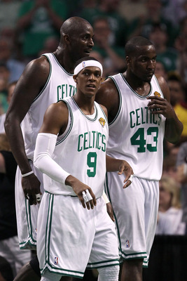 BOSTON - JUNE 08:  (L-R) Kevin Garnett #5, Rajon Rondo #9 and Kendrick Perkins #43 of the Boston Celtics look on in the second half against the Los Angeles Lakers in Game Three of the 2010 NBA Finals on June 8, 2010 at TD Garden in Boston, Massachusetts.