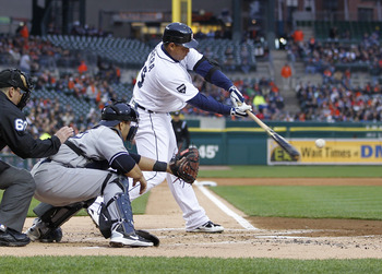 DETROIT, MI - MAY 03: Miguel Cabrera #24 of the Detroit Tigers hits a sacrifice fly to score Scott Sizemore #20 in the first inning in front of Russell Martin #55 of the New York Yankees at Comerica Park on May 3, 2011 in Detroit, Michigan. Detroit won th