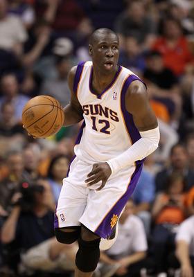 PHOENIX, AZ - MARCH 13:  Mickael Pietrus #12 of the Phoenix Suns handles the ball during the NBA game against the Orlando Magic at US Airways Center on March 13, 2011 in Phoenix, Arizona.  NOTE TO USER: User expressly acknowledges and agrees that, by down