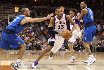 PHOENIX, AZ - MARCH 27:  Grant Hill  #33 of the Phoenix Suns drives the ball past  Jason Kidd #2 of the Dallas Mavericks during the NBA game at US Airways Center on March 27, 2011 in Phoenix, Arizona.  The Mavericks defeated the Suns 91-83.  NOTE TO USER: