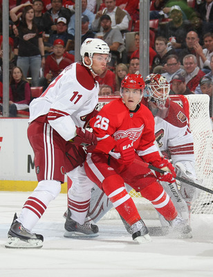 DETROIT, MI- APRIL 13:  Jiri Hudler #26 of the Detroit Red Wings battles for position with Martin Hanzal #11 of the Phoenix Coyotes in Game One of the Western Conference Quarterfinals during the 2011 NHL Stanley Cup Playoffs at Joe Louis Arena on April 13