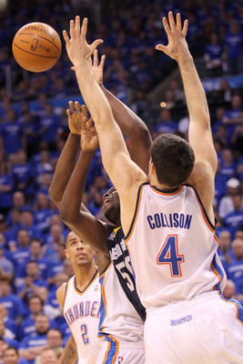 OKLAHOMA CITY, OK - MAY 03:  Zach Randolph #50 of the Memphis Grizzlies goes up for a shot over Nick Collison #4 of the Oklahoma City Thunder in the first quarter of Game Two of the Western Conference Semifinals in the 2011 NBA Playoffs on May 3, 2011 at