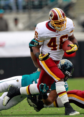JACKSONVILLE, FL - DECEMBER 26: Austen Lane #92 of the Jacksonville Jaguars attempts to tackle Ryan Torain #46 of the Washington Redskins during the game at EverBank Field on December 26, 2010 in Jacksonville, Florida.  (Photo by Sam Greenwood/Getty Image