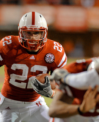 LINCOLN, NE - NOVEMBER 13: Rex Burkhead #22 of the Nebraska Cornhuskers scores a touchdown during first half action of their game at Memorial Stadium on November 13, 2010 in Lincoln, Nebraska. Nebraska  (Photo by Eric Francis/Getty Images)