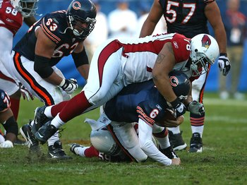 CHICAGO - NOVEMBER 08: Jay Cutler #6 of the Chicago Bears is sacked by Will Davis #59 and flattened by Alan Branch #78 of the Arizona Cardinals at Soldier Field on November 8, 2009 in Chicago, Illinois. The Cardinals defeated the Bears 41-21.  (Photo by J