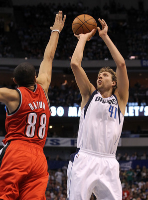 DALLAS, TX - APRIL 16:  Forward Dirk Nowitzki #41 of the Dallas Mavericks takes a shot against Nicolas Batum #88 of the Portland Trail Blazers in Game One of the Western Conference Quarterfinals during the 2011 NBA Playoffs on April 16, 2011 at American A