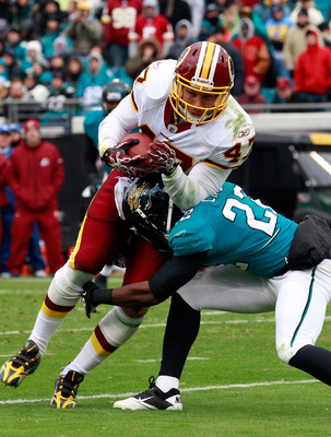 JACKSONVILLE, FL - DECEMBER 26:  Don Carey #22 of the Jacksonville Jaguars attempts to tackle Chris Cooley #47 of the Washington Redskins during the game at EverBank Field on December 26, 2010 in Jacksonville, Florida.  (Photo by Sam Greenwood/Getty Image