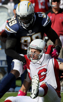 SAN DIEGO - OCTOBER 3:  Linebacker Kevin Burnett  #99 of the San Diego Chargers sacks quarterback Max Hall #3 of the Arizona Cardinals and causes a fumble at Qualcomm Stadium on October 3, 2010 in San Diego, California.   The Chargers won 41-10.  (Photo b