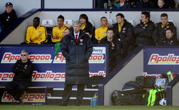 WEST BROMWICH, ENGLAND - MARCH 19: Arsene Wenger manager of Arsenal looks on from the away dugout during the Barclays Premier League match between West Bromwich Albion and Arsenal at The Hawthorns on March 19, 2011 in West Bromwich, England.  (Photo by Sc