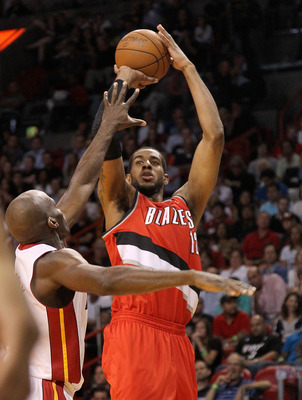 MIAMI, FL - MARCH 08:  LaMarcus Aldridge #12 of the Portland Trail Blazers shoots over Joel Anthony #50 of the Miami Heat during a game at American Airlines Arena on March 8, 2011 in Miami, Florida. NOTE TO USER: User expressly acknowledges and agrees tha
