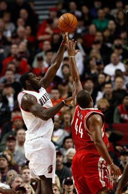 PORTLAND, OR - OCTOBER 27:  Greg Oden #52 of the Portland Trail Blazers shoots over Chuck Hayes #44 of the Houston Rockets during the season opener on October 27, 2009 at the Rose Garden in Portland, Oregon. NOTE TO USER: User expressly acknowledges and a