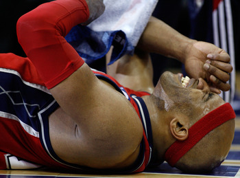 CLEVELAND - MAY 08:  Vince Carter #15 of the New Jersey Nets winces in pain after getting injured late in the fourth quarter against the Cleveland Cavaliers in Game Two of the Eastern Conference Semifinals during the 2007 NBA Playoffs at Quicken Loans Are