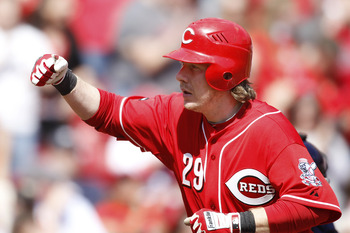 CINCINNATI, OH - APRIL 3: Ryan Hanigan #29 of the Cincinnati Reds celebrates as he rounds the bases after the first of two home runs against the Milwaukee Brewers at Great American Ball Park on April 3, 2011 in Cincinnati, Ohio. The Reds won 12-3. (Photo